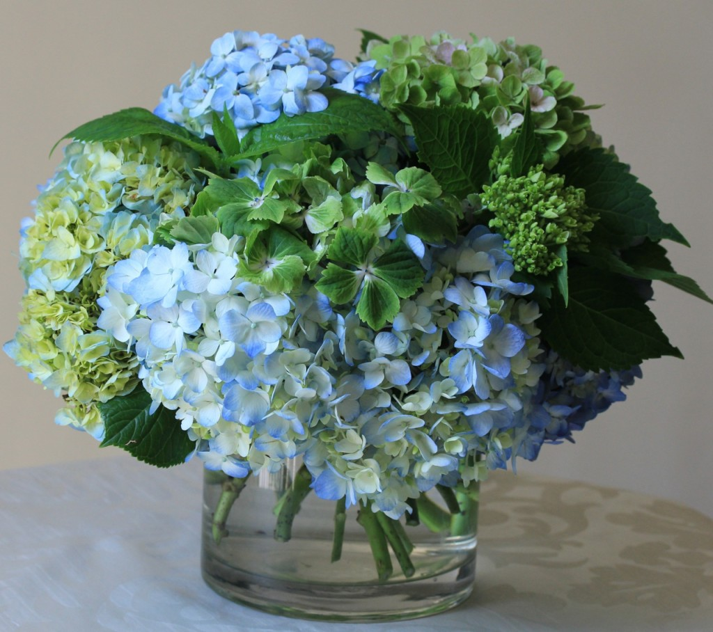Vase with blue and green flowers