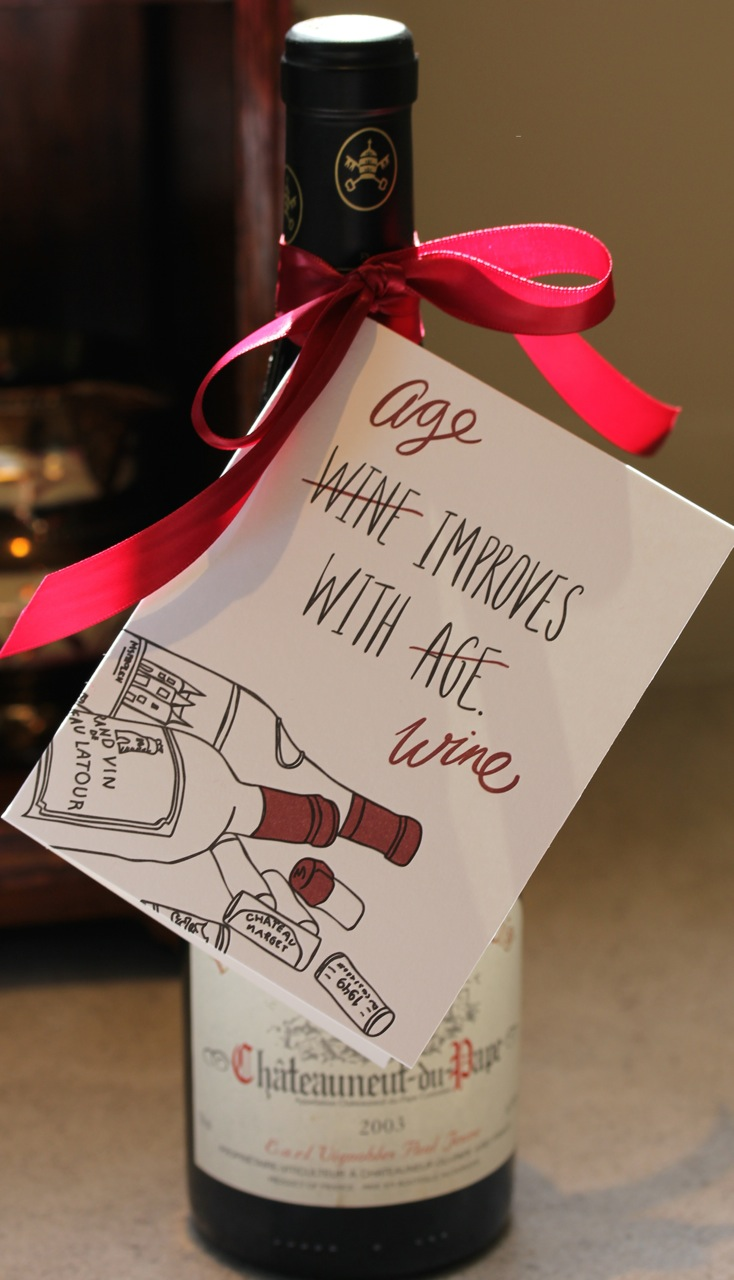 Wine bottle with red and white note