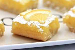 Lemon squares with lemon wedge